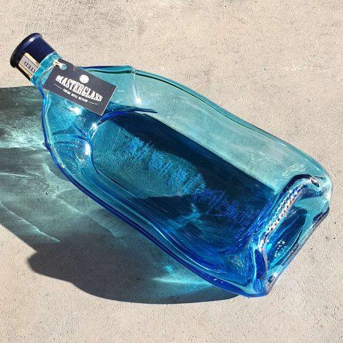 Tot borrelplank gesmolten fles Bombay